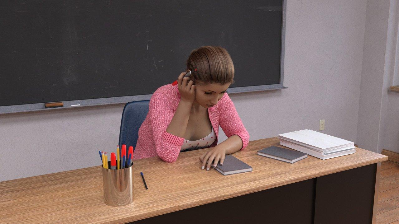 Nauczycielka siedząca przy biurku.