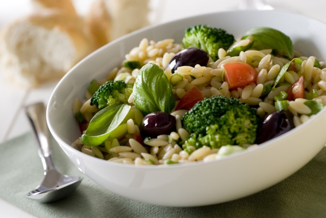 orzo pasta salad with fresh herbs and vegetables.